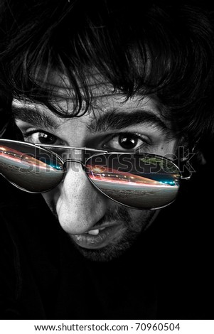 Strange View on a Man's Headshot with City Lights Reflecting in Glasses - stock photo
