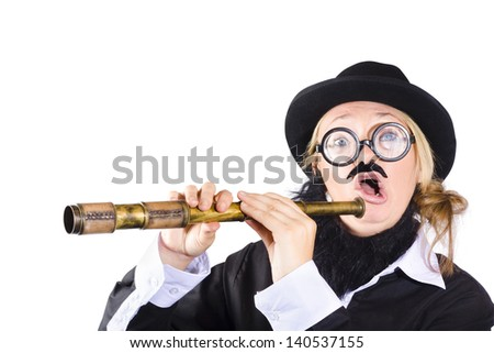 Strange woman in disguise wearing black bowler hat , fake beard and mustache , wide rimmed glasses  holding extended antique telescope - stock photo