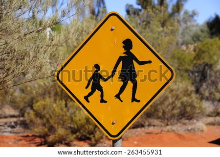 Strange yellow people crossing sign in the outback of australia - stock photo