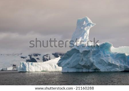 Strangely shaped iceberg - stock photo