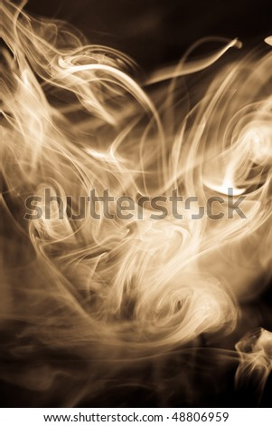 strangely shaped puff of smoke on black - stock photo