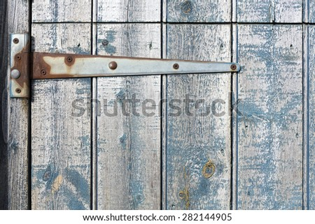 Strap hinge on old wooden stable door. - stock photo