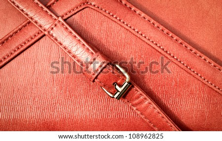 strap with a lock on the leather texture