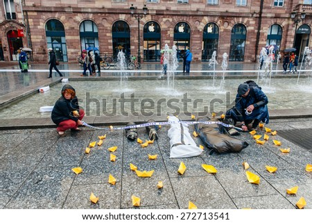 STRASBOURG, FRANCE - APR 26 2015 Arranging Frontex line over dead corps protest against immigration policy and border management which asks for commitment in the wake of migrants boat disasters - stock photo