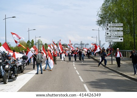 STRASBOURG, FRANCE - APR 30, 2016: Closed street as crowd protest against government regional reform for the fusion of the Alsace region with Lorraine and Champagne-Ardenne