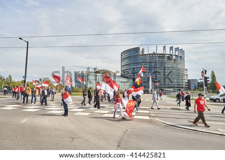 STRASBOURG, FRANCE - APR 30, 2016: Closed street at European Parliament as crowd protest against government regional reform for the fusion of the Alsace region with Lorraine and Champagne-Ardenne