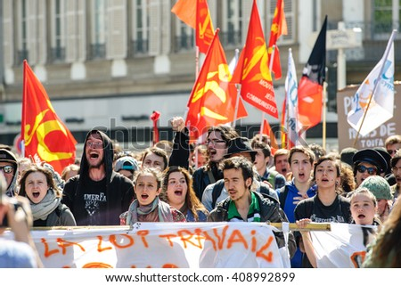 STRASBOURG, FRANCE - APR 20, 2016: Crowd yelling as hundreds of people demonstrate as part of nationwide day of protest against proposed labor reforms by Socialist Government