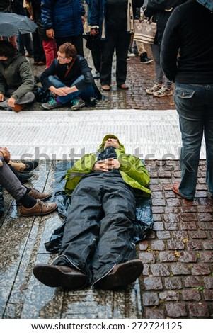 STRASBOURG, FRANCE - APR 26 2015: Die-in protest against immigration policy and border management which asks for commitment in the wake of migrants boat disasters
