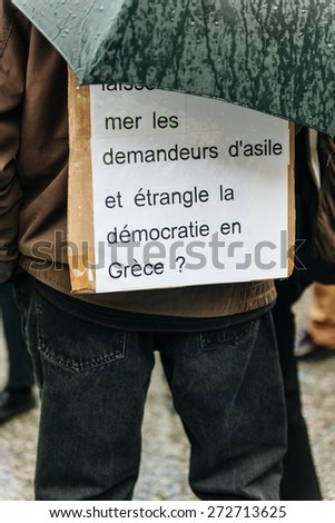 STRASBOURG, FRANCE - APR 26 2015: Man with placard at protest against immigration policy and border management which asks for commitment in the wake of migrants boat disasters