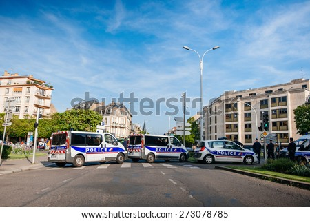 STRASBOURG, FRANCE - APRIL 24, 2015: Police vans blocking Strasbourg streets while the Armenian protesters march for 100th remembrance year of Armenian genocide in 1915