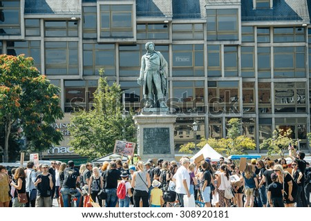 STRASBOURG, FRANCE - AUG 22, 2015: Marine conservation  organization Sea Shepherd protesting against the slaughter of pilot whales and arrest of 7 crew members - people protesting agains massacre - stock photo