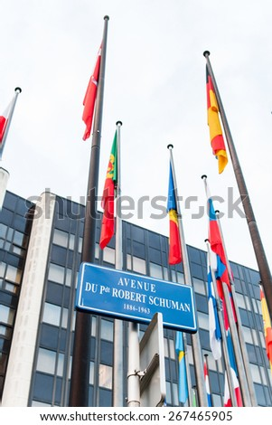 STRASBOURG, FRANCE - FEBRUARY 04, 2015: Exterior of Council of Europe with all European Union member flags and street avenue name of President Robert Schumann - stock photo