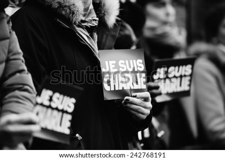 STRASBOURG, FRANCE - JAN 09, 2015: Council of Europe employees and Thorbjorn Jagland - Secretary General of the CE attend to a silent vigil to condemn the gun attack at French magazine Charlie Hebdo - stock photo