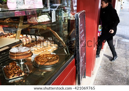 STRASBOURG, FRANCE - JAN 20, 2016: French traditional bakery pastry store in the center of Strabourg with diverse cakes and eclairs