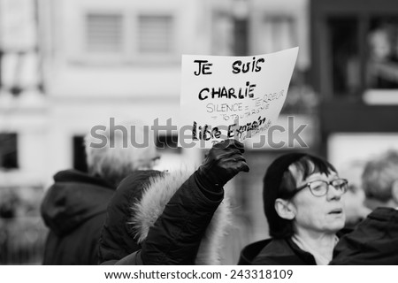 STRASBOURG, FRANCE - 11 JAN, 2015:  People hold placards reading 'Je suis Charlie' during a unity rally (Marche Republicaine) where some 50000 took part in tribute three-day killing spree in Paris - stock photo