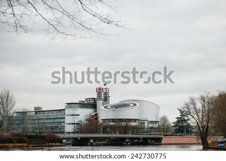 STRASBOURG, FRANCE - 8 JAN 2015: The  European Union Flag flies at half-mast on top of the European Court of Human rights following an attack the day before against French satirical  Charlie Hebdo - stock photo