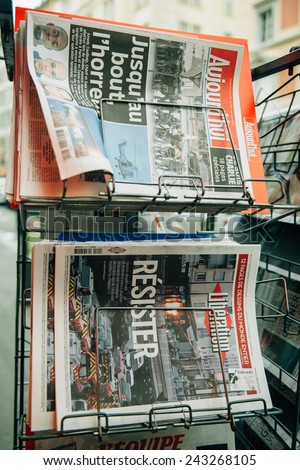 STRASBOURG, FRANCE - 10 JAN, 2015: The front covers of International newspapers display headlining the terrorist attacks yesterday in Paris on January 8, 2015 - stock photo