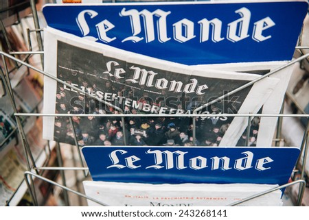 STRASBOURG, FRANCE - 10 JAN, 2015: The front covers of International newspapers display of Le Monde Magazine  headlining the terrorist attacks yesterday in Paris on January 8, 2015 - stock photo