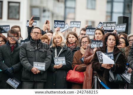 STRASBOURG, FRANCE - JANUARY 09, 2015: Council of Europe employees attend to a silent vigil to condemn the gun attack magazine Charlie Hebdo office in Paris, which killed 12 people on January 7, 2015 - stock photo