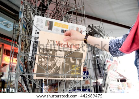 STRASBOURG, FRANCE - JUN 25, 2016: Woman buying Financial Times newspaper with shocking James Cameron PM headline titles about the Brexit referendum in United Kingdom to quit the European Union - stock photo