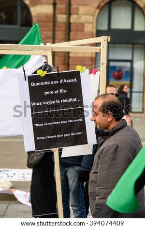 STRASBOURG, FRANCE - MAR 19, 2016 40 years of Assad - you see the result placard as Syrian diaspora protests in center of Strasbourg to denouncing the Syrian attacks and show solidarity Syrian people