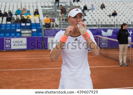 Strasbourg, France - May 14, 2016 - Kristina Mladenovic drinks water between two games