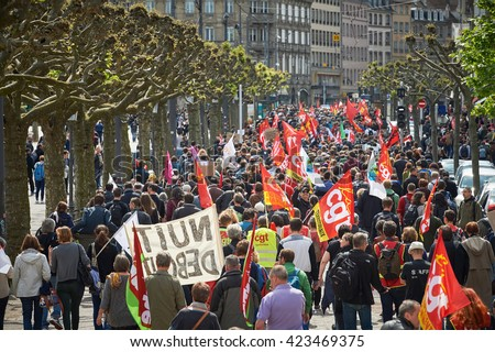 STRASBOURG, FRANCE - MAY 19, 2016: Perspective view of crowd on Place Broglie during a demonstrations against proposed French government's labor and employment law reform - stock photo