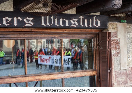 STRASBOURG, FRANCE - MAY 19, 2016: Reflection of protesters in Winstub Restaurant during a demonstrations against proposed French government's labor and employment law reform - stock photo