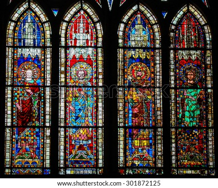 STRASBOURG, FRANCE - MAY 9, 2015: Stained glass depicting Holy Roman Emperor Lothar I (795-855) and his three sons and heirs Louis II, Lothar II and Charles in the cathedral of Strasbourg, France - stock photo