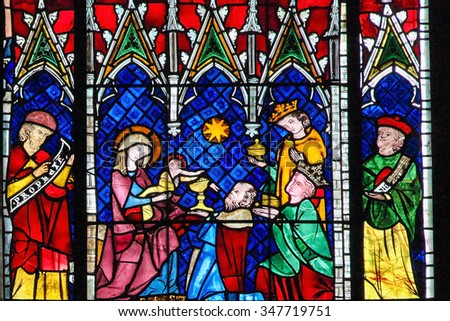 STRASBOURG, FRANCE - MAY 9, 2015: Stained glass depicting the Adoration of the Magi in the cathedral of Strasbourg, France - stock photo