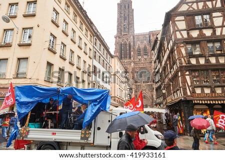 STRASBOURG, FRANCE - MAY 12, 2016:Van with music band in front of  thousand of people demonstrate as part of nationwide day of protest against labor reforms by France Government