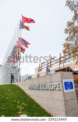 STRASBOURG, FRANCE - 14 Nov 2015: All European Union Flag flies at half-mast in front of the Council of Europe following an terrorist attack in Paris - stock photo
