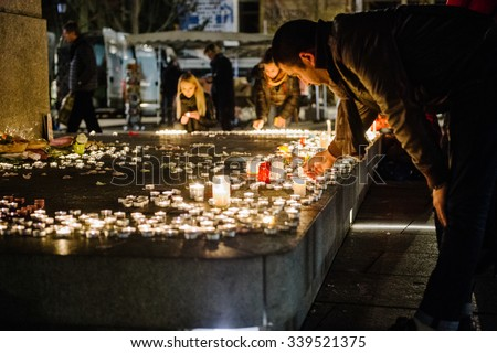 STRASBOURG, FRANCE - 14 NOV 2015: People attend a vigil and light candles in the center of Strasbourg for the victims of the November 13 attacks in Paris that killed at least 128 people - stock photo