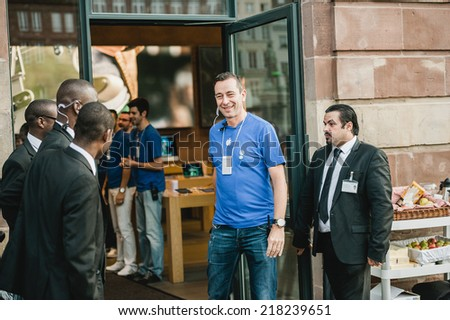 STRASBOURG, FRANCE - SEPTEMBER 19, 2014: Apple manager smiling before opening the doors for the customers to the company's Place Kleber store for the sales launch of the iPhone 6 and iPhone 6 Plus - stock photo
