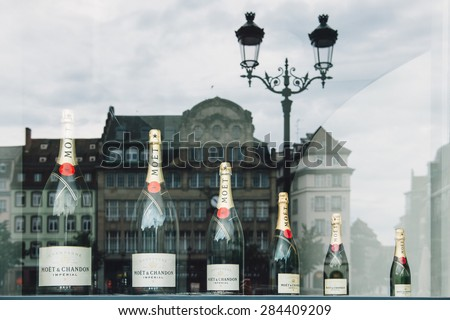 STRASBOURG, FRANCE - SEPTEMBER 21, 2014: Moet & Chandon or Moet different sizes of bottles, is a French winery and co-owner of the luxury goods company Moet-Hennessy Louis Vuitton.  - stock photo