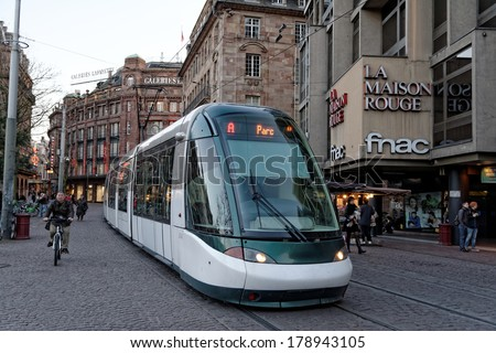 STRASBOURGH, FRANCE - FEB 17 2014: Kleber Strasbourg tram stop in the square is serving thousands of passengers every day - stock photo