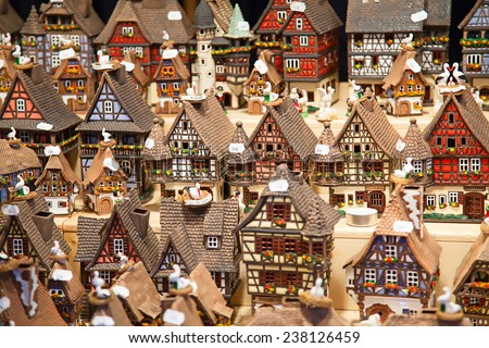 STRASSBOURG - DECEMBER 23: Colorful Alsatian houses on the Christmas market in Strasbourg on December 23, 2013 in Strasbourg, France. Christmas market is famous tourist attraction of the city.  - stock photo