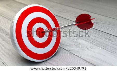 strategic business solutions, marketing or corporate strategy concept: digital generated dart in the center of a red target, modern wooden background. - stock photo