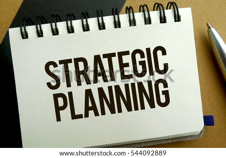 Strategic planning memo written on a notebook with pen