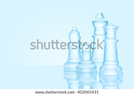 Strategy and leadership concept; frosted chess figures made of ice, standing together ready for game as on a family photo. - stock photo