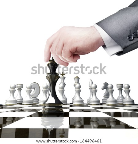 Strategy concept. hand holding black chess figure on chess board  isolated on white background High resolution  - stock photo