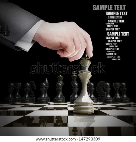 Strategy concept. hand holding white chess figure on chess board. isolated on black background.  - stock photo