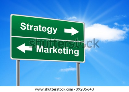 Strategy marketing road sign on background clouds and sunburst. - stock photo