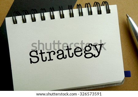 Strategy memo written on a notebook with pen