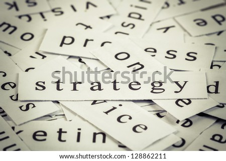 Strategy topic in cut paper on the top of the others word