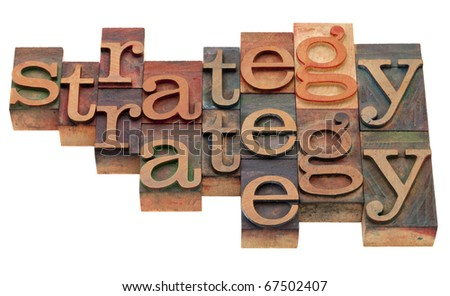 strategy word abstract in vintage wooden letterpress printing blocks, stained by color inks, isolated on white - stock photo
