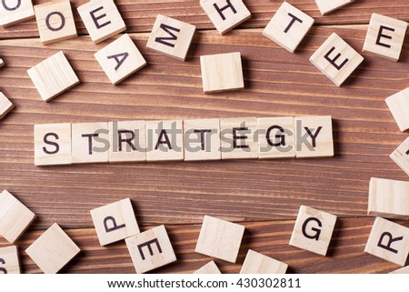 Strategy word on wooden cubes, success in business concept.