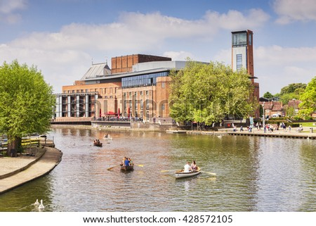 Stratford on Avon, England: 29 May 2016 - Royal Shakespeare Theatre and  River Avon and  people in boats on the river on a sunny weekend in late spring, Stratford-upon-Avon, Warwickshire, England, UK