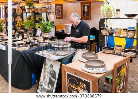 STRATFORD-UPON-AVON, ENGLAND - SEPTEMBER 13, 2013: Craftsman is producing ceramic pots at the fair city.  - stock photo