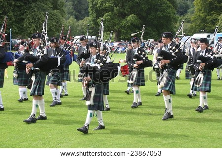 STRATHPEFFER, SCOTLAND - AUGUST, 9: bagpipes' parade at the Highland Games August 9, 2008 in Strathpeffer, Scotland. - stock photo